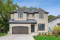 Luxury homes Stunning home features a large paver patio and a new fence