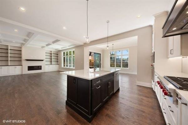 Mansions Stunning home features a large paver patio and a new fence