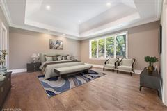 Stunning home features a large paver patio and a new fence luxury real estate