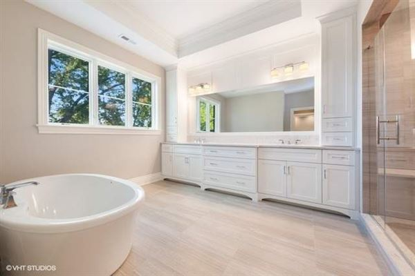 Stunning home features a large paver patio and a new fence luxury homes