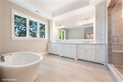 Stunning home features a large paver patio and a new fence luxury properties