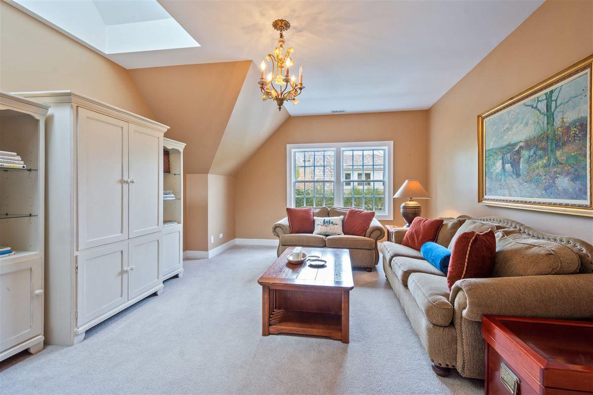 Stone and cedar Cape Cod home luxury homes