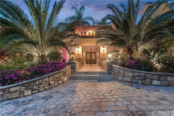 Luxury properties grand Mediterranean residence includes a courtyard