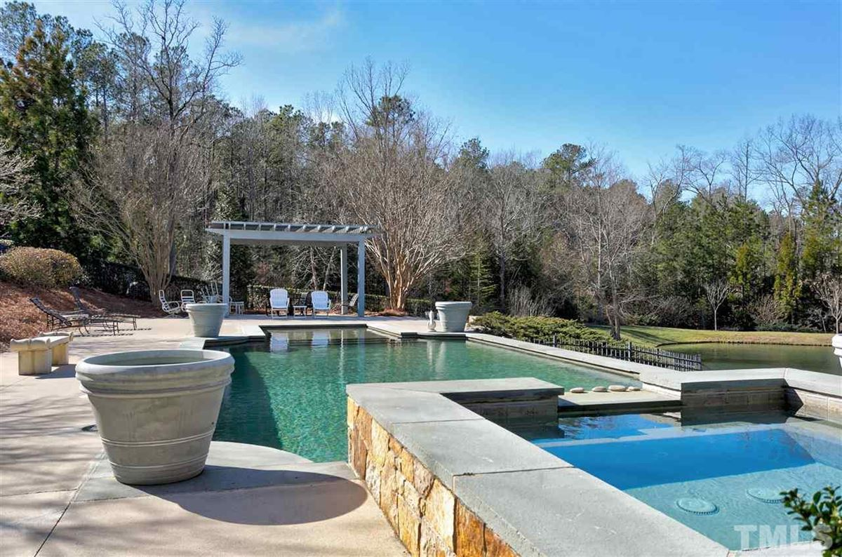 exclusive home includes a pool and spa mansions
