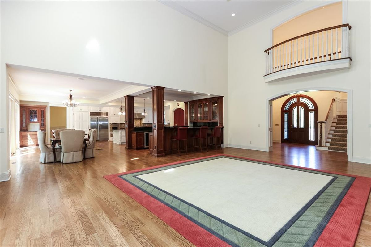 Luxury properties gorgeous custom home on three private wooded acres