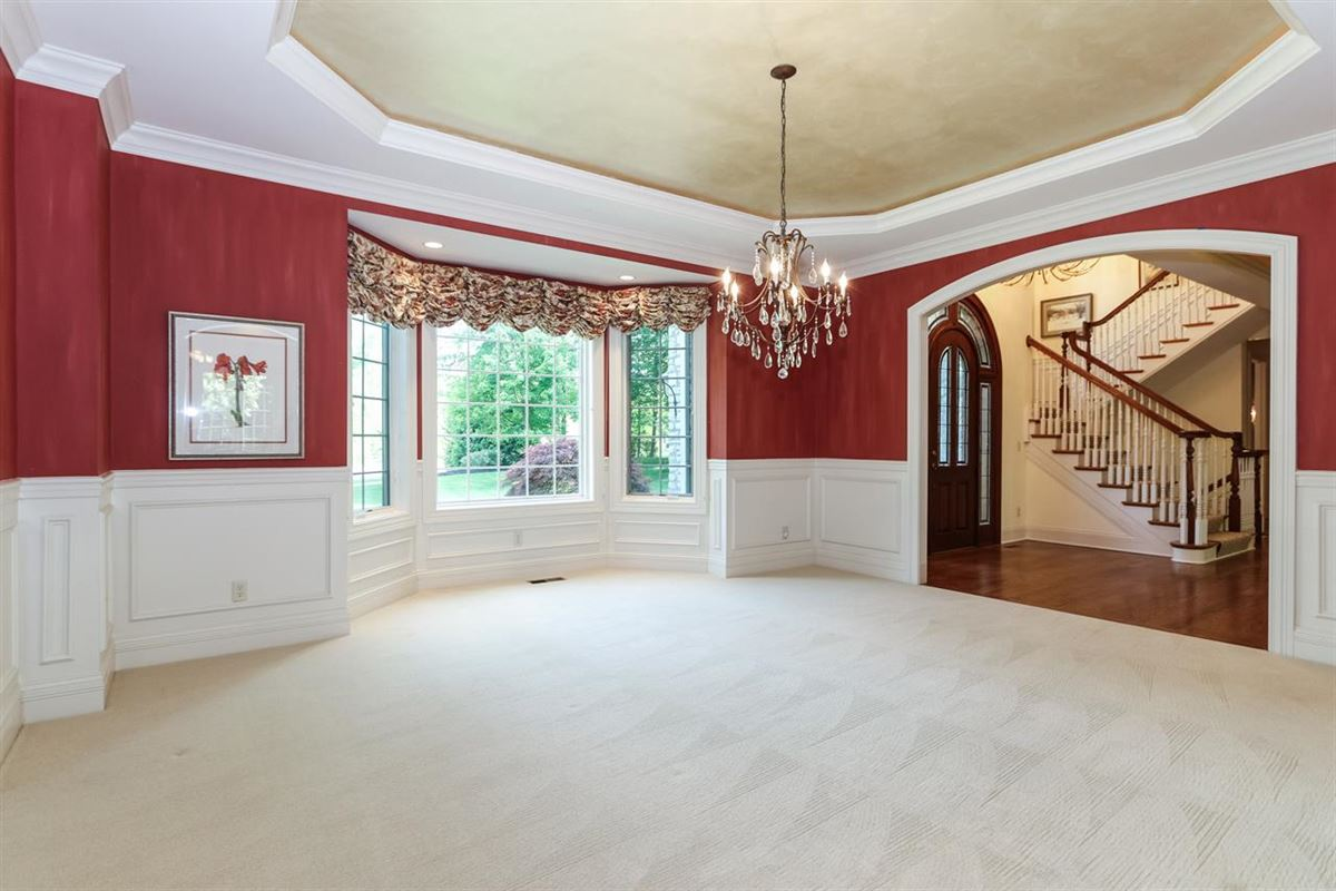 Mansions gorgeous custom home on three private wooded acres