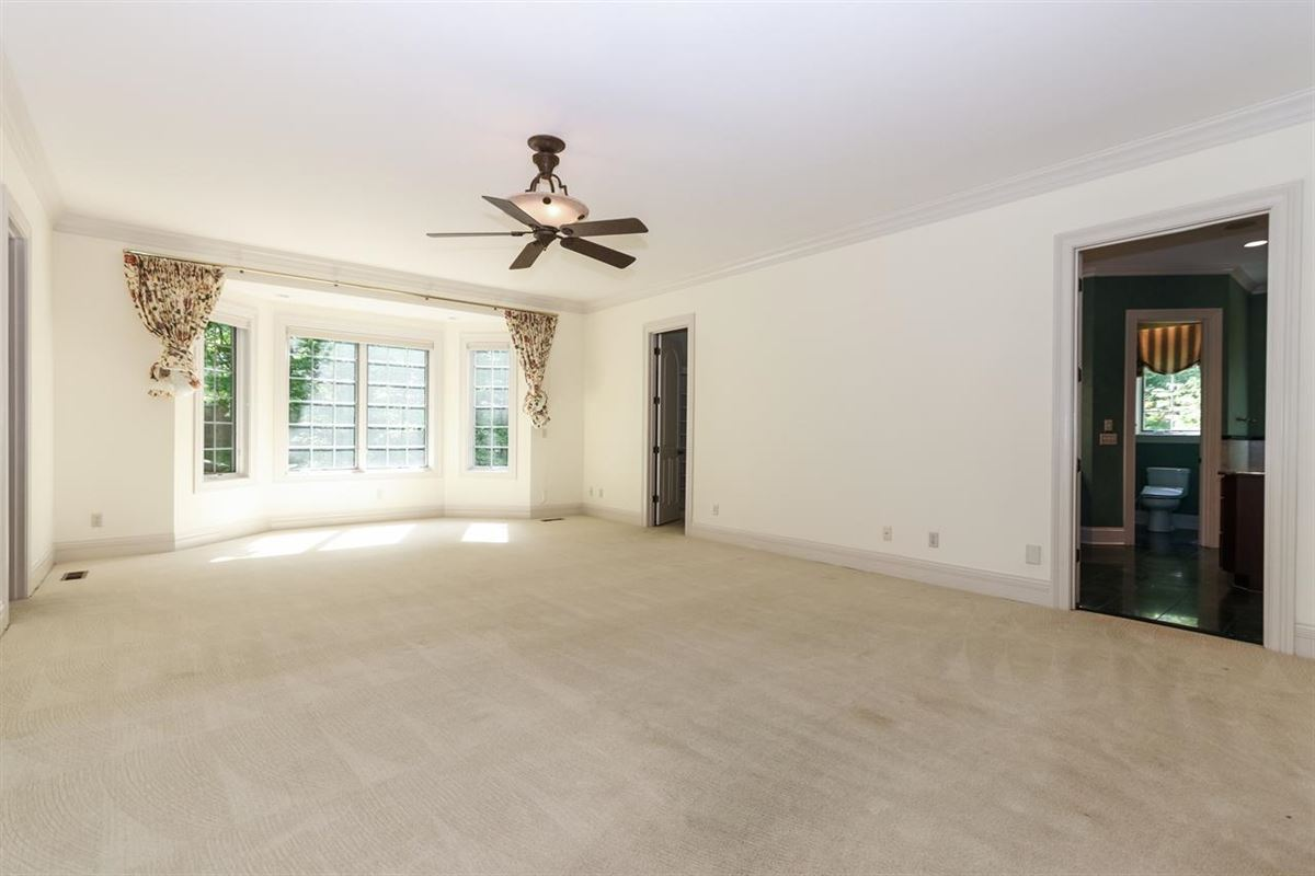 gorgeous custom home on three private wooded acres luxury real estate