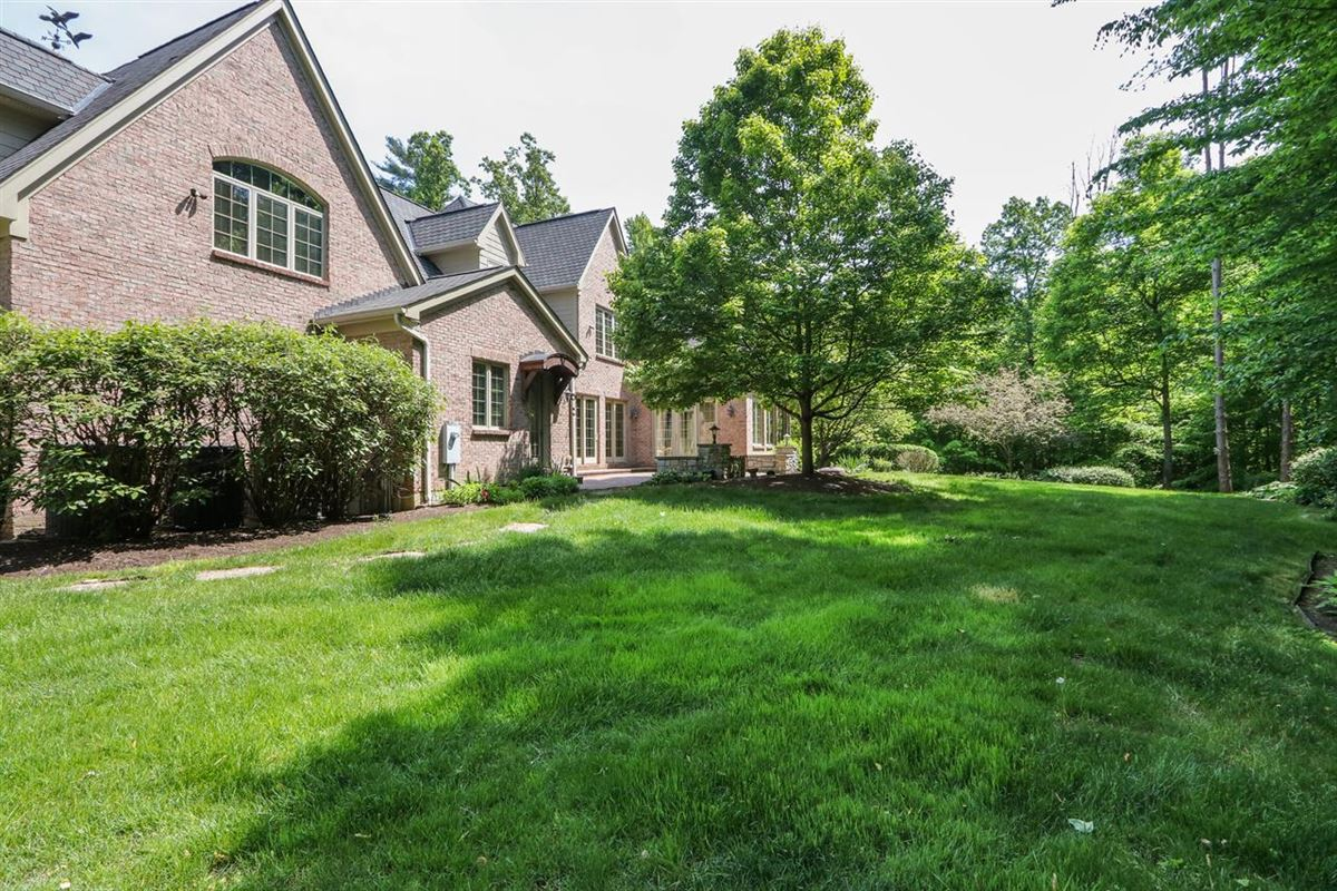 Luxury homes in gorgeous custom home on three private wooded acres