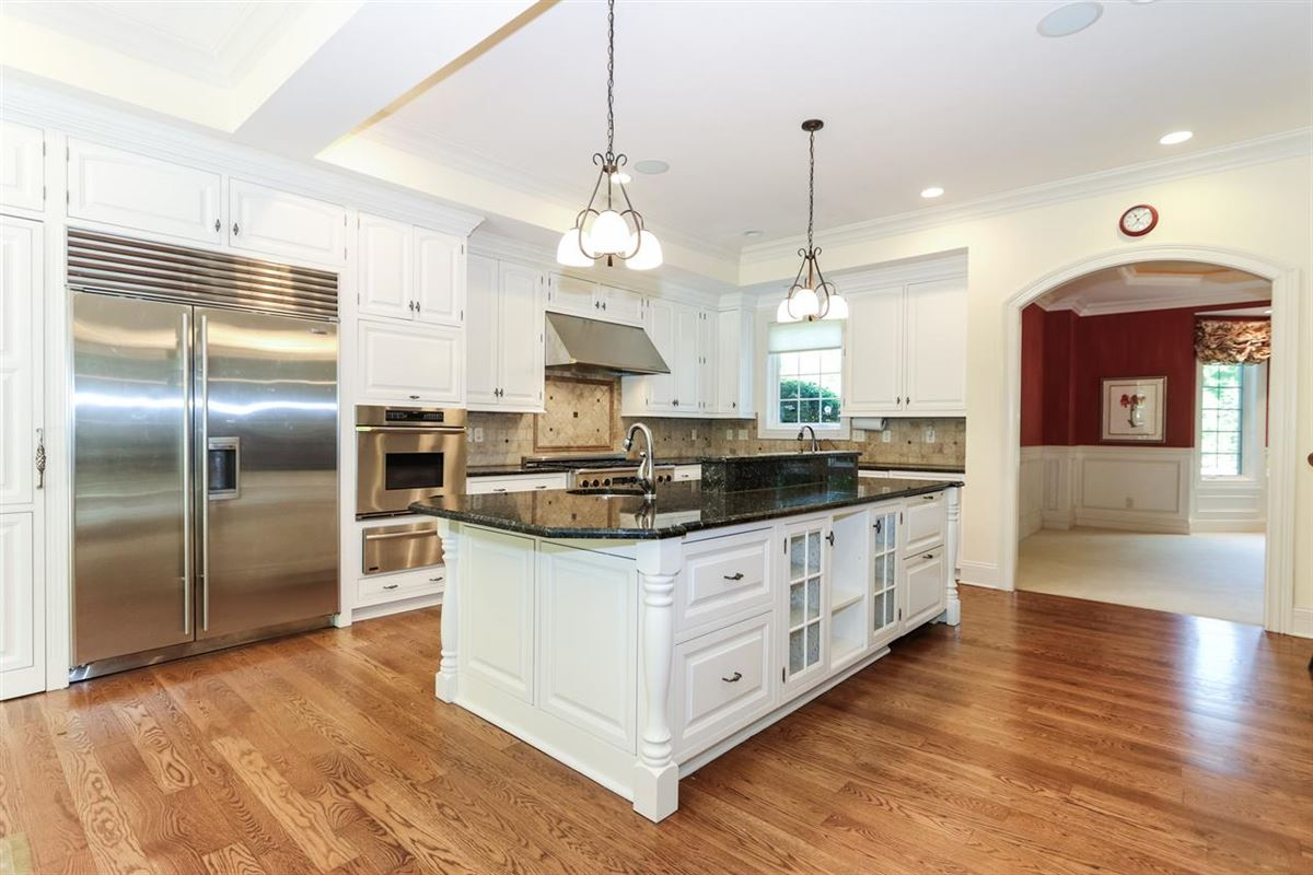 gorgeous custom home on three private wooded acres luxury properties