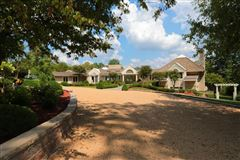 Stunning ranch on very private three acres luxury properties