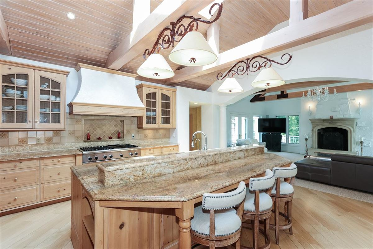 Stunning ranch on very private three acres luxury homes