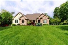 Beautiful custom ranch on three wooded acres luxury properties