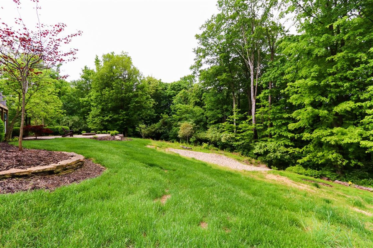 Luxury properties Beautiful custom ranch on three wooded acres