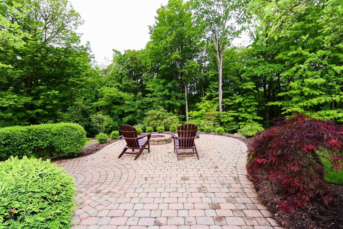 Mansions Beautiful custom ranch on three wooded acres