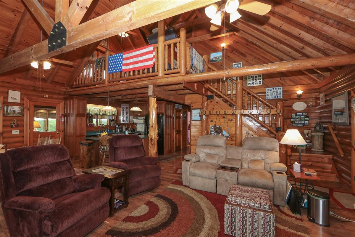 Beautiful, 79-acre equestrian estate with log home luxury real estate