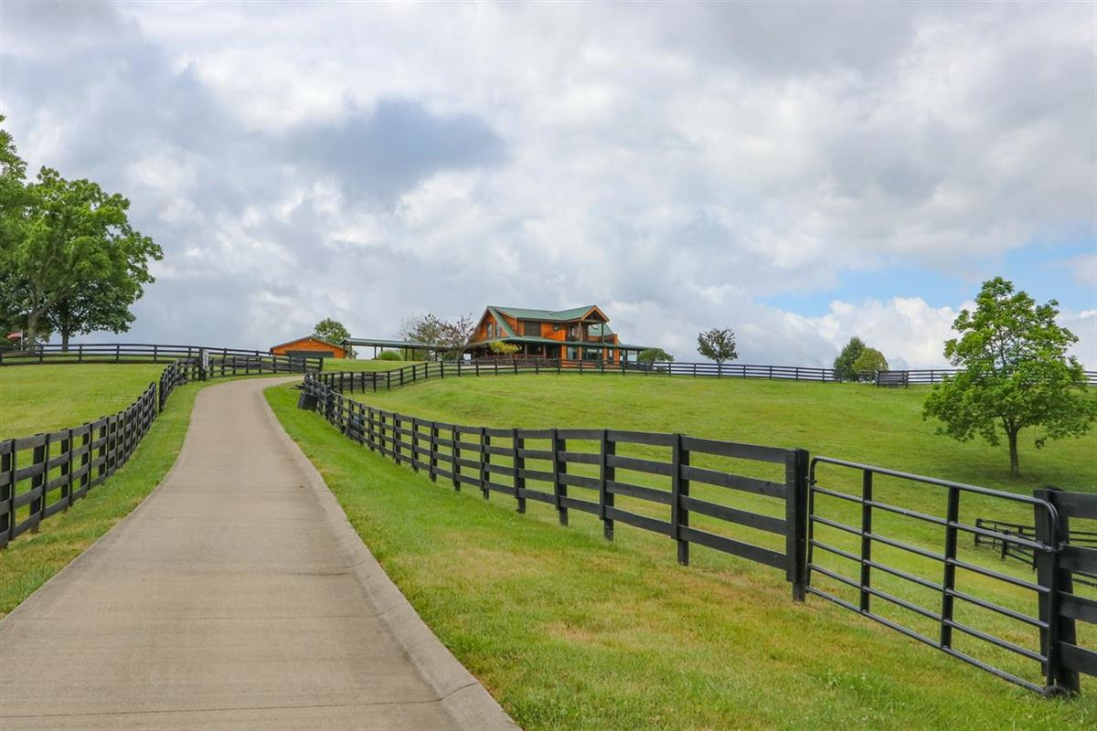Beautiful, 79-acre equestrian estate with log home mansions