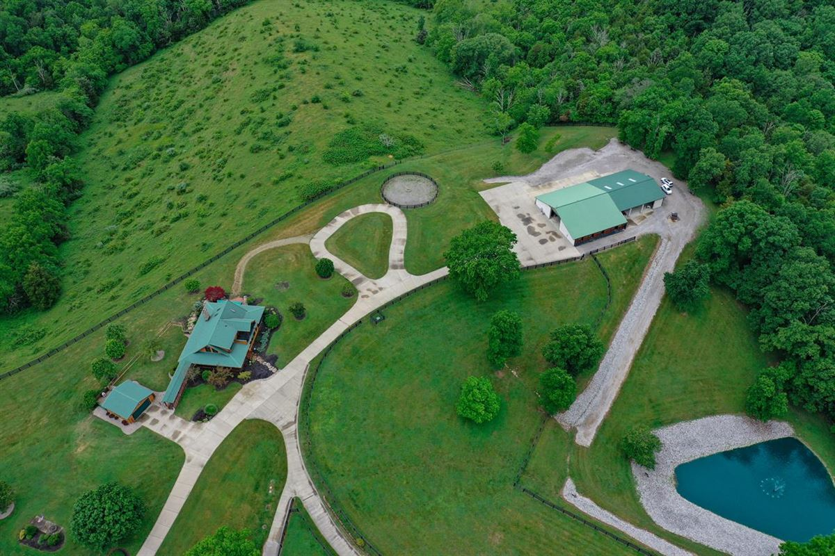 Luxury real estate Beautiful, 79-acre equestrian estate with log home