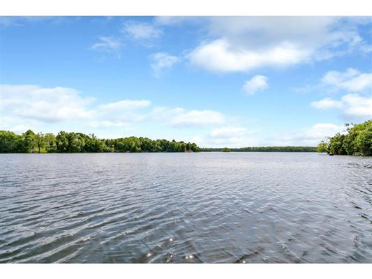 Luxury properties Nearly six acres on a private lake peninsula