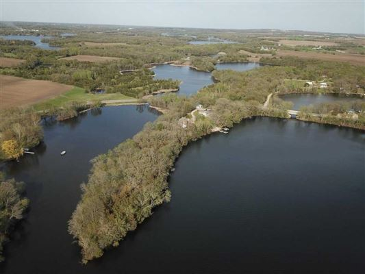 Nearly six acres on a private lake peninsula luxury properties
