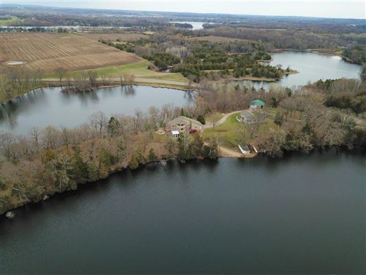 Mansions Nearly six acres on a private lake peninsula