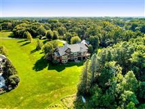 Mansions in expansive estate on private Gem Lake