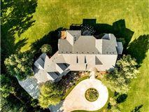 Mansions expansive estate on private Gem Lake