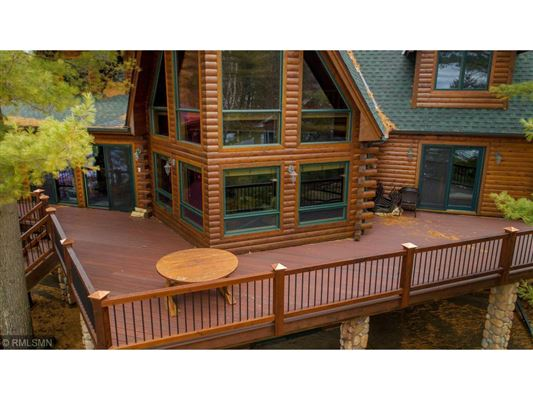 Rush Lake log home with sand beach luxury homes