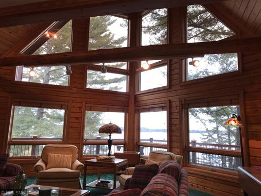 Rush Lake log home with sand beach luxury properties
