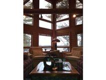Luxury homes in Rush Lake log home with sand beach