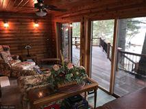 Luxury properties Rush Lake log home with sand beach