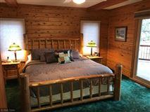 Mansions Rush Lake log home with sand beach