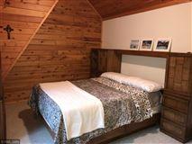 Luxury homes Rush Lake log home with sand beach