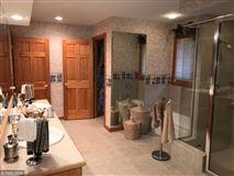 Rush Lake log home with sand beach luxury real estate