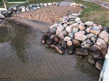 Luxury real estate Rush Lake log home with sand beach