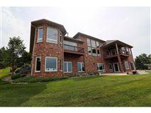 Elegant custom built all brick Ranch luxury properties