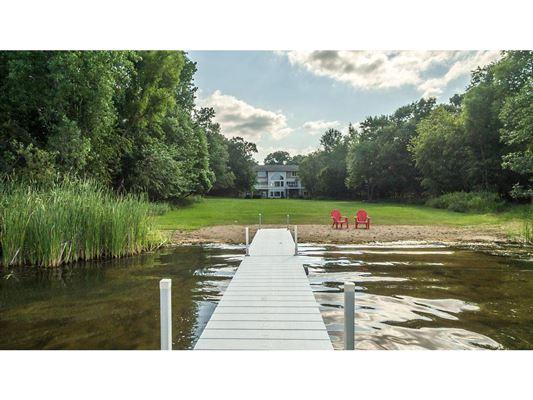 Golden opportunity on a secret gem of a lake mansions