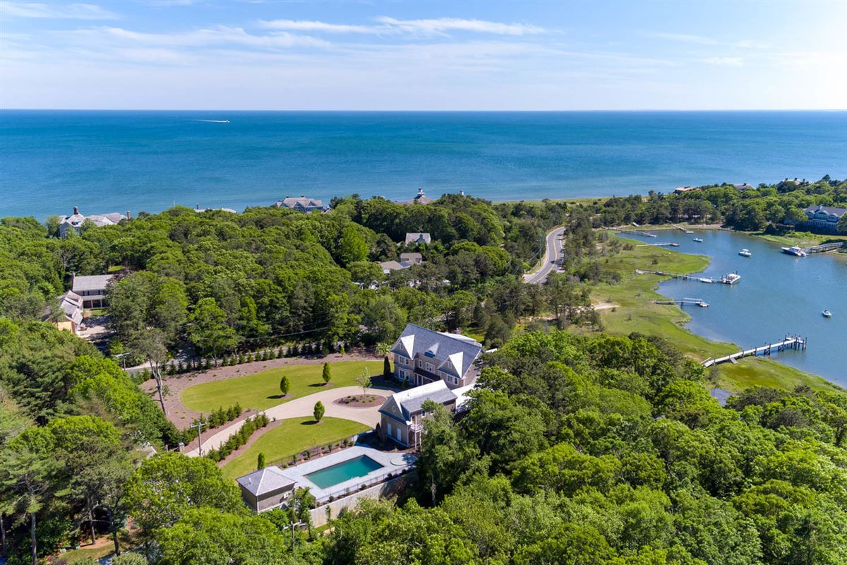 Luxury homes in custom designed waterfront home with expansive views