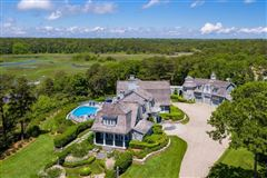 landmark estate overlooking Pinquickset Cove luxury properties