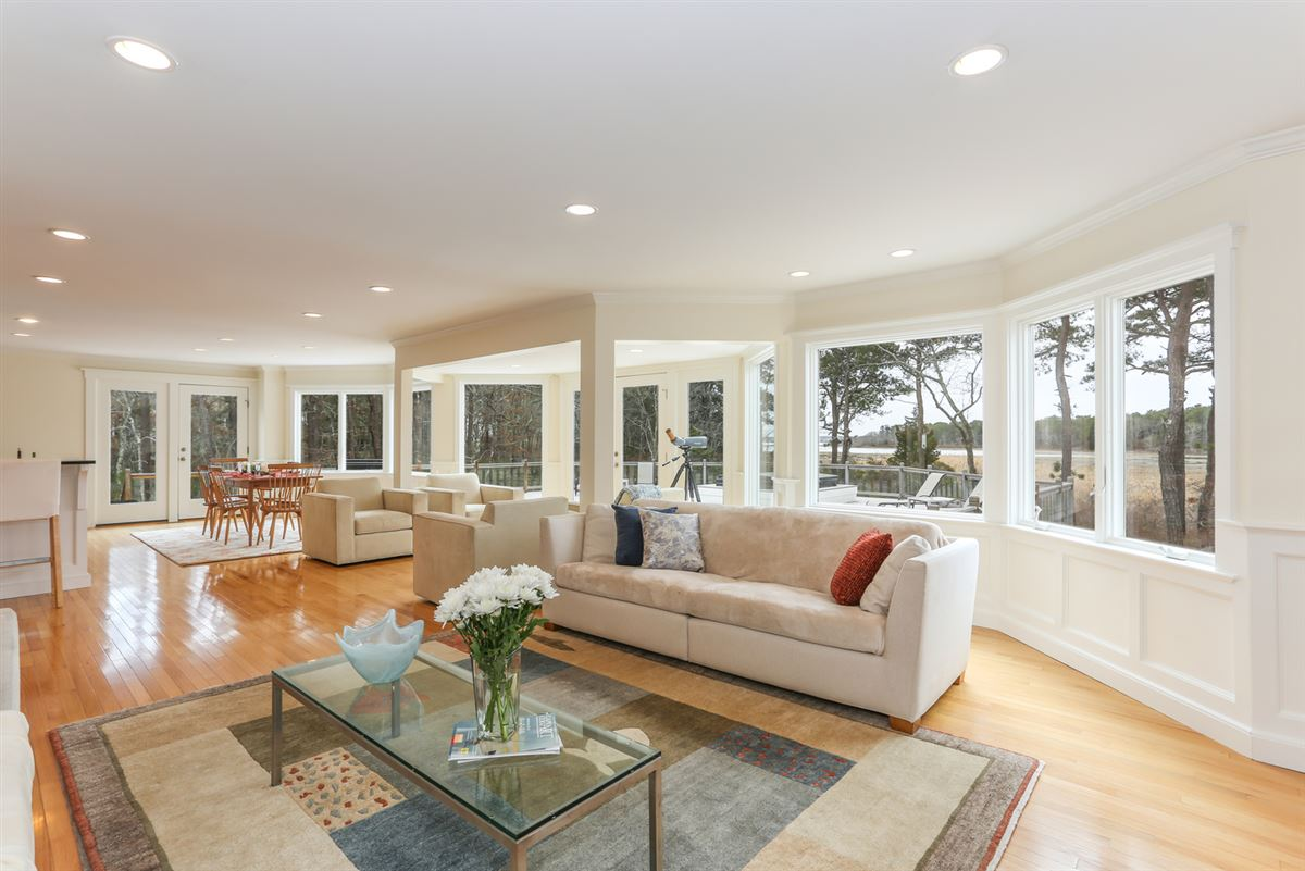 Luxury properties This stylish home Enjoys captivating marsh views