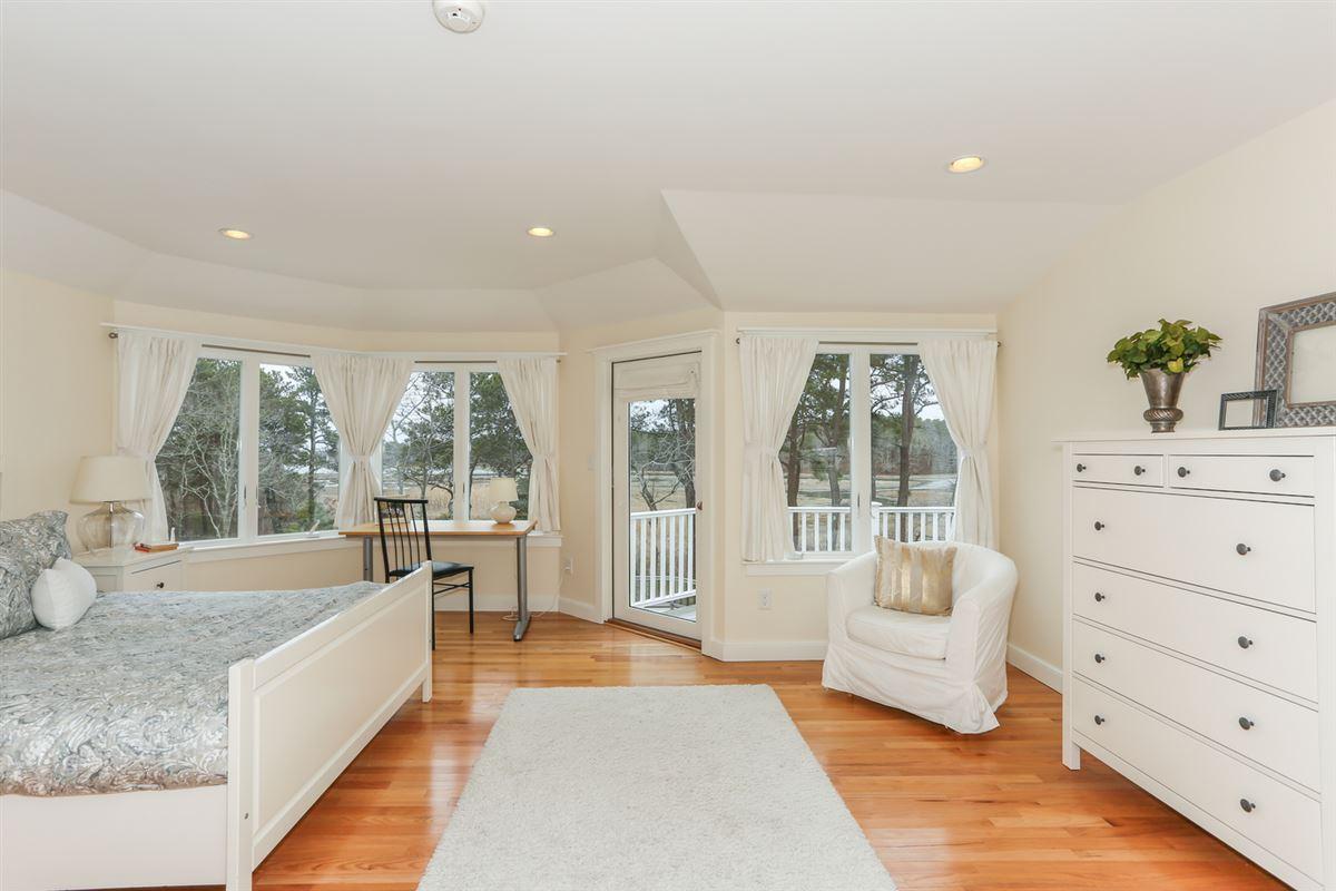 Luxury real estate This stylish home Enjoys captivating marsh views