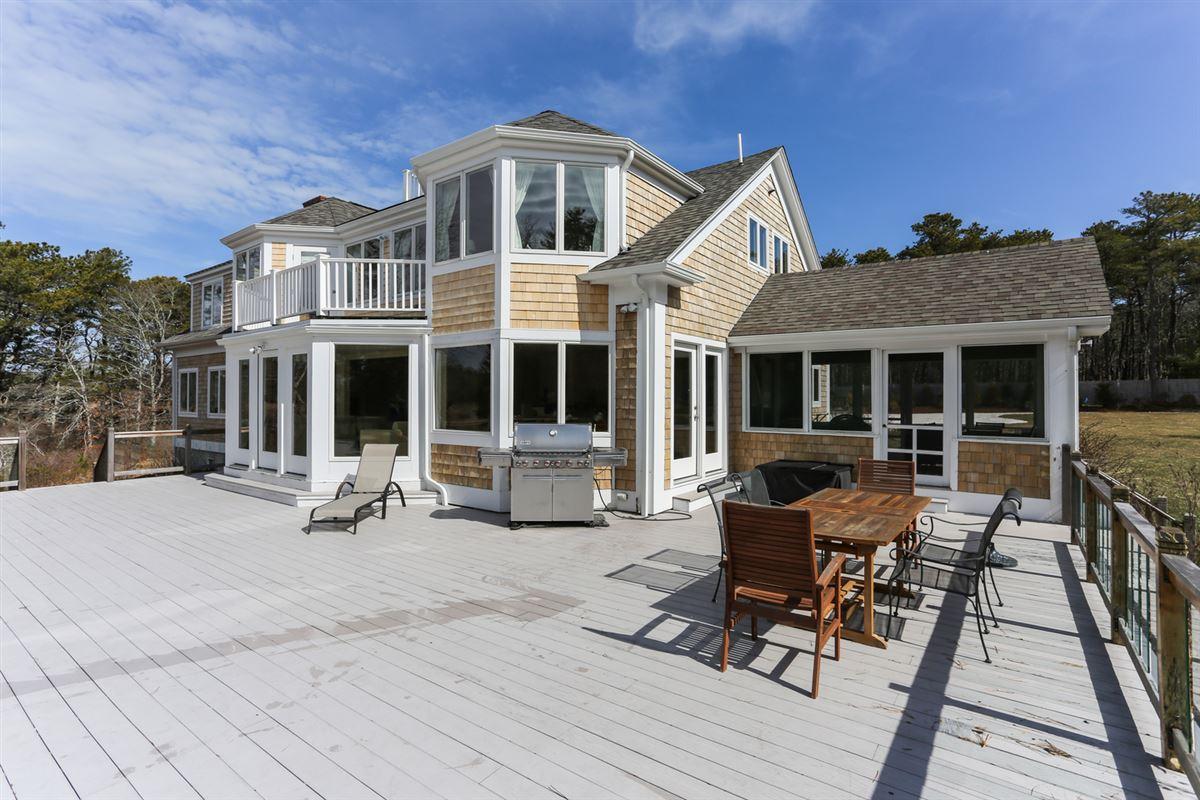 This stylish home Enjoys captivating marsh views luxury properties