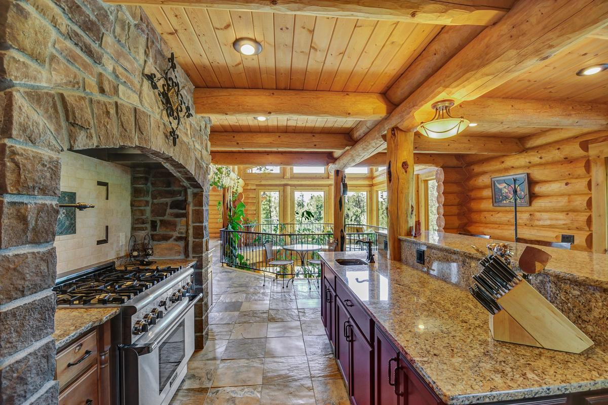 Elegant Log Design on 10-plus Acres luxury properties
