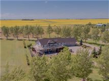 Luxury properties custom bungalow on beautiful prairie oasis with Mountain View