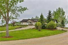 custom bungalow on beautiful prairie oasis with Mountain View luxury properties