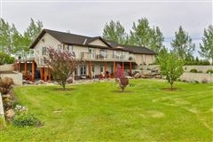Luxury real estate custom bungalow on beautiful prairie oasis with Mountain View