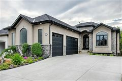 Luxury homes in Spacious Walkout Bungalow on the Beautiful Bow River