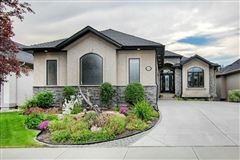 Mansions in Spacious Walkout Bungalow on the Beautiful Bow River