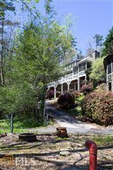 Mansions in cedar shake cottage on Lake Burton