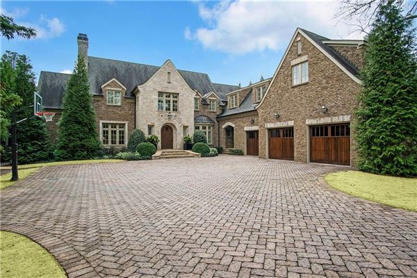 manor home on a private gated lot in chastain park mansions