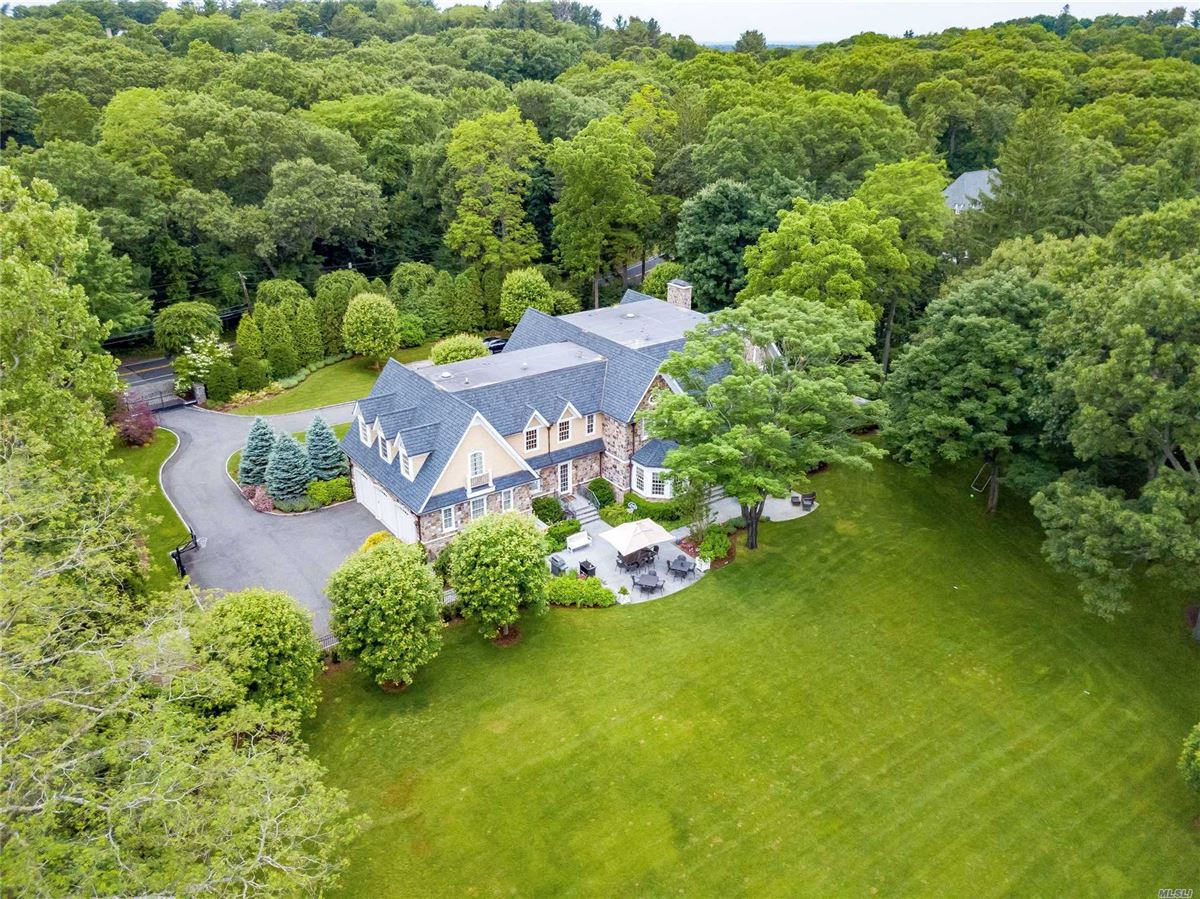 Luxury properties immaculate home on two gated acres